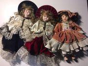 drei Puppen aus voll-Porzellan mit