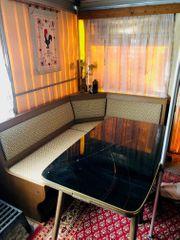 Esszimmertisch mit schwarzer Glasplatte 60er