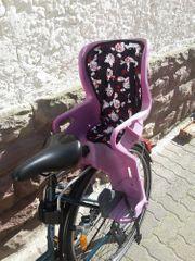Britax Römer Fahrradsitz Jockey lila