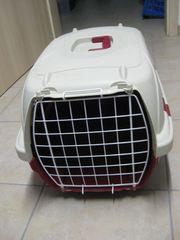 Katzentoilette und Transportkorb