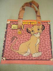 Mädchentasche aus orangefarbenem Waschleder mit