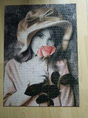 Puzzle Mädchen mit Rose