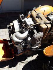 Weinbergtraktor mit Seilwinde Wippsäge Stihl