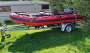 Schlauchboot mit Motor und Trailer