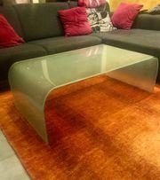 Designer Glastisch aus einem Stück