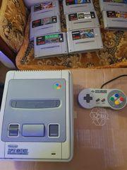 Super Nintendo mit einem Controller