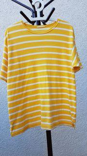 Strahlendes Feinstrick-Shirt in der Modefarbe
