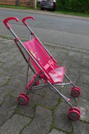 Rosa Puppenwagen