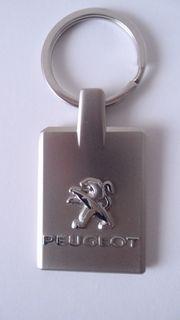 Peugeot Schlüsselanhänger silber Metall NEU