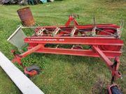 Pöttinger Bandrechen Schwader für Traktor