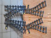 4 graue verstellbare Lego RC-Schienen