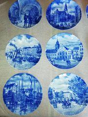 12 Wandteller aus der Serie