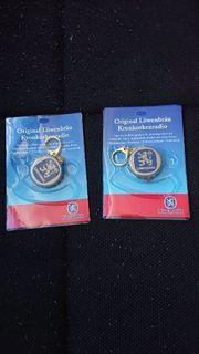 Original verpackte Kronkorkenradios von Löwenbrau