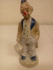 Porzellan Clown und verschiedene Püppchen