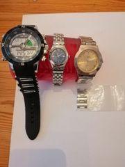 Drei Armbanduhren