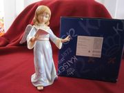 Engel mit Notenblatt Antik-blau von