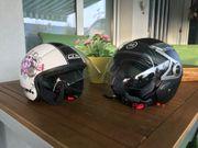 2 Motorrad- bzw Rollerhelme