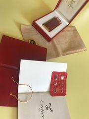 Cartier Feuerzeug Trinity Chinalack rot