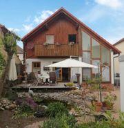 Charmant Wohnen mit idyllischem Garten -