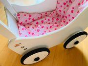 Puppenwagen mit Lauflernhilfe und Zubehör