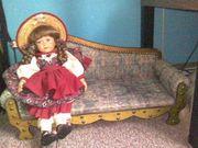 Süsse Puppe mit Strohhut