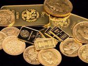 Münzen und Barren aus Gold