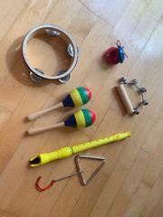 Set aus 6 Musikinstrumenten für