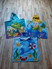 3 bunte Handtuch Ponchos mit