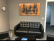 Couchgarnitur mit Glastisch