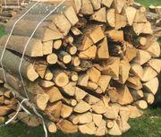 Ofenfertiges Brennholz Kaminholz Feuerholz zu