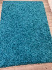 Türkis blauer Teppich
