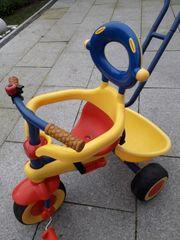 Dreirad mit Babyaufsatz und Führungsstange