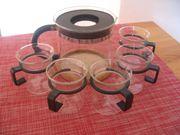 Teekanne mit passenden Gläsern von