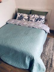Bett mit Aufbewahrung