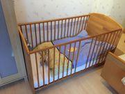 Kinderbett aus Holz mit Matratze