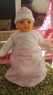 Puppenbett mit Puppe