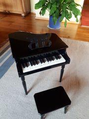 Kinder Klavier Flügel aus Hocker