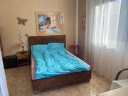 Schlafzimmer mit Bett 140 x