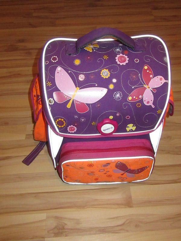 ebfc051bb3af4 Schulranzen Schulrucksack Jako-o mit lila Schmetterlingsdesign für ...