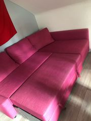 Sofa pink ausziehbar Tisch
