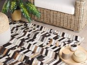 Teppich Kuhfell braun weiß 160