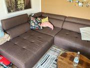 Sofa mit elektrischer Ausfahrfunktion