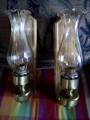2 getönte Wandlampen