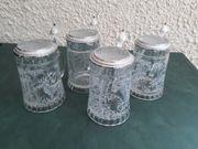 Bierkrüge aus Glas mit Deckel