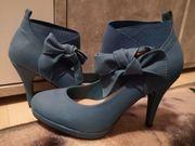 biete getragene Schuhe an