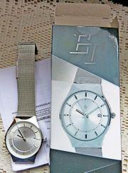 Superflache ungetragene Marken-Armbanduhr mit Milanaise-Uhrenarmband