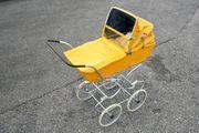 Alter vintage Kinderwagen Puppenwagen orange
