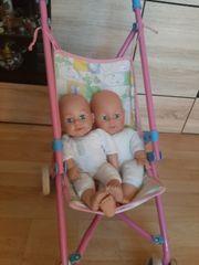 2 Puppen mit puppenwagen one