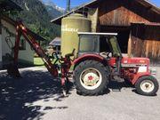 Traktor mit Moser Mistbagger