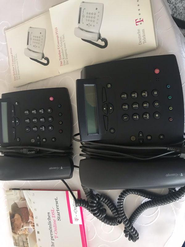 2 Telefone mit komplettem Zubehör